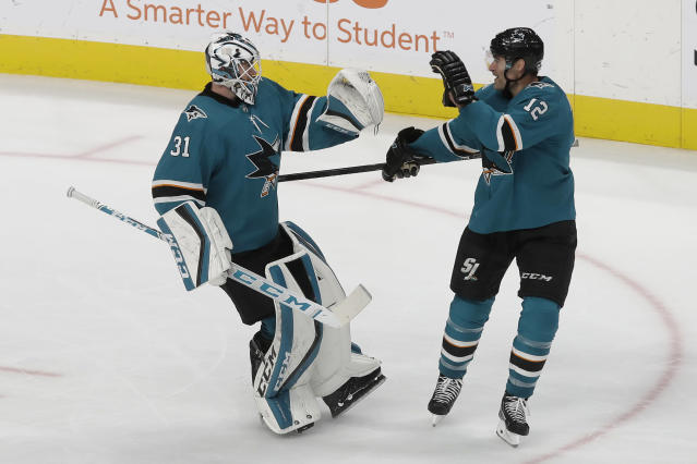 San Jose Sharks goaltender Martin Jones (31) celebrates with center Patrick Marleau (12) after the Sharks defeated the Detroit Red Wings in an NHL hockey game in San Jose, Calif., Saturday, Nov. 16, 2019. The Sharks won 4-3 in a shootout. (AP Photo/Jeff Chiu)