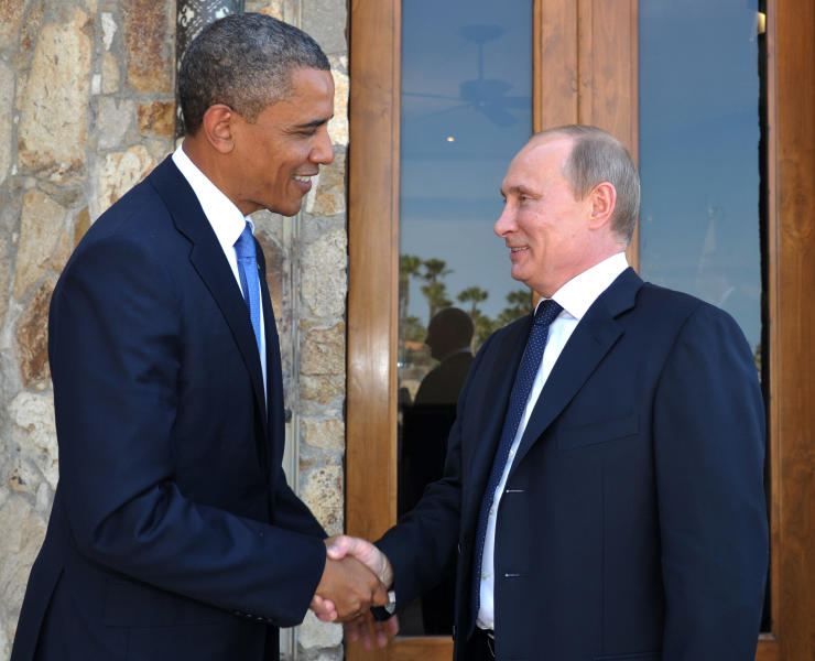 U.S. President Barack Obama, left, greets Russia's President Vladimir Putin at the G-20 Summit in Los Cabos, Mexico, Monday, June 18, 2012. President Barack Obama and Russian President Vladimir Putin huddle on the sidelines of the G-20 meeting in Mexico, in what officials say will be a candid, get-down-to-business meeting about their mutual interests and disagreements. It's their first meeting since Putin returned to Russia's top job. (AP Photo/RIA-Novosti, Alexei Nikolsky, Presidential Press Service)