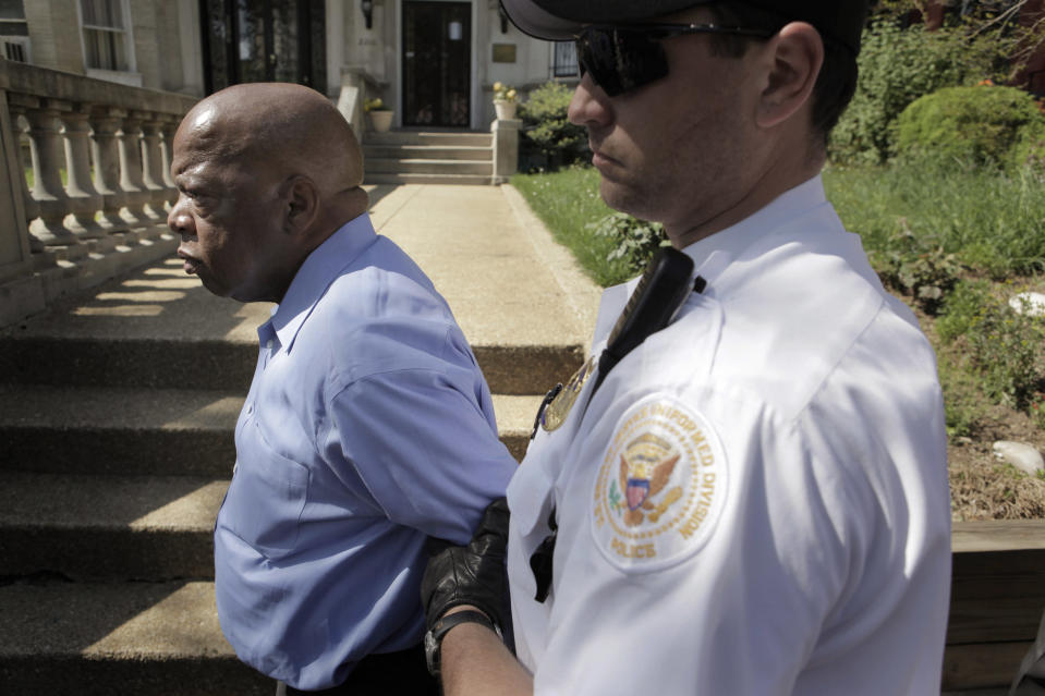 Rep. John Lewis, D-Ga., left, is arrested during a protest at the Sudanese Embassy against the actions of the Sudanese government in Darfur on Monday, April 27, 2009, in Washington. Lewis as well as other humanitarian leaders and lawmakers, were led away in handcuffs Monday after crossing a police line. (Photo: Evan Vucci/AP)