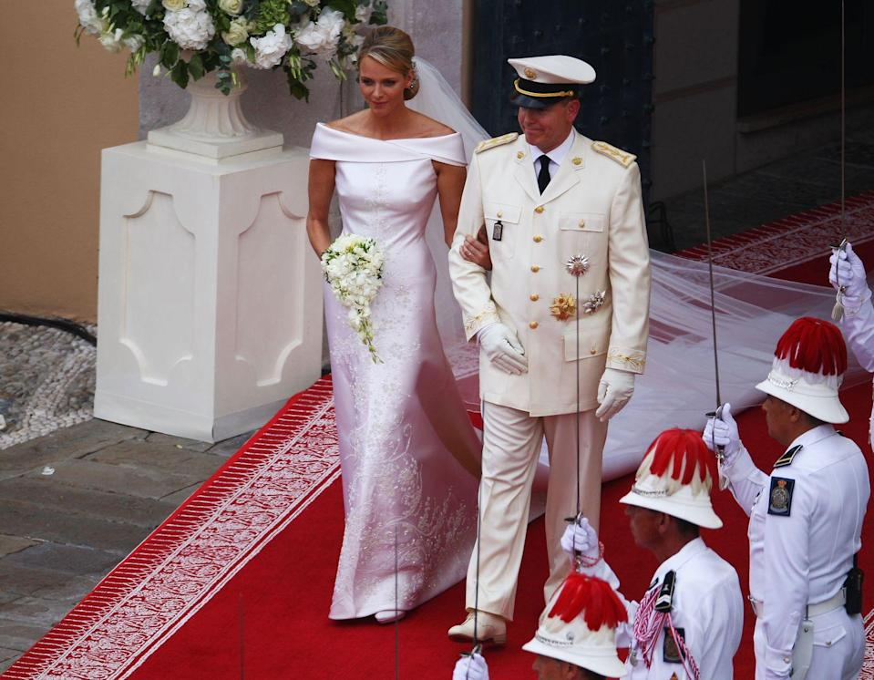 <p>Princess of Monaco Charlene Wittstock and Prince Albert II were married on July 2, 2011 at the Prince's Palace of Monaco. Princess Charlene's Armani dress featured an off-the-shoulder top and embroidery consisting of 40,000 Swarovski crystals, 20,000 mother of pearl teardrops, and 30,000 gold stones.</p>
