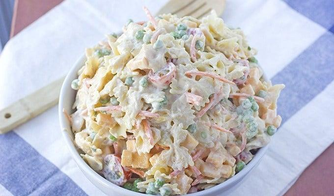 """<p>It's a fact, picnics and cold pasta go hand-in-hand. This lunch-ready meal is full of sweet peas, grape tomatoes, shredded carrots, sharp cheddar cheese, and delicious spices that work together to maximize the flavor. If you want to put a ranch-flavored spin on this recipe, add a dash of light ranch dressing to make it complete.</p> <p><strong>Get the recipe:</strong> <a href=""""https://bsugarmama.com/picnic-pasta-salad-recipe/"""" class=""""link rapid-noclick-resp"""" rel=""""nofollow noopener"""" target=""""_blank"""" data-ylk=""""slk:picnic pasta salad"""">picnic pasta salad</a></p>"""
