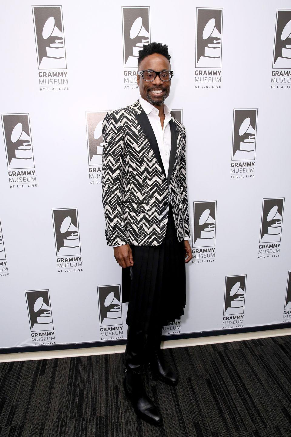 <p>Porter at a Grammy Museum event in a chevron-printed blazer, a pleated skirt, and leather pants. </p>
