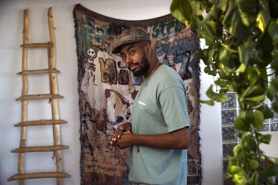 """Streetwear designer Kacey Lynch is photographed at his office in downtown Los Angeles. Lynch created his clothing line because he saw an opening in the market for a brand rooted in Black culture. <span class=""""copyright"""">(Mel Melcon / Los Angeles Times)</span>"""