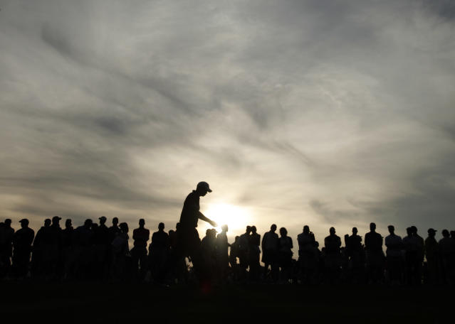 <p>Tiger Woods walks down the 18th fairway during the first round of the Masters golf tournament at the Augusta National Golf Club in Augusta, Ga., Thursday, April 9, 2009. Woods finished the round with a two-under par. (AP Photo/Charlie Riedel) </p>