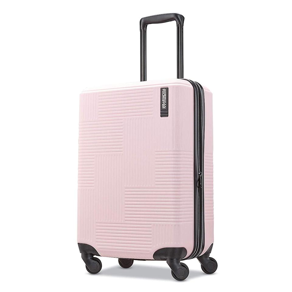 """<p>If you love pink, you obviously have to get this <a href=""""https://www.popsugar.com/buy/American-Tourister-Stratum-XLT-Hardside-Carry--Suitcase-444890?p_name=American%20Tourister%20Stratum%20XLT%20Hardside%20Carry-On%20Suitcase&retailer=amazon.com&pid=444890&price=70&evar1=savvy%3Aus&evar9=45287485&evar98=https%3A%2F%2Fwww.popsugar.com%2Fsmart-living%2Fphoto-gallery%2F45287485%2Fimage%2F46414061%2FAmerican-Tourister-Stratum-XLT-Hardside-Carry--Suitcase&list1=shopping%2Ctravel%2Camazon%2Cluggage&prop13=mobile&pdata=1"""" rel=""""nofollow"""" data-shoppable-link=""""1"""" target=""""_blank"""" class=""""ga-track"""" data-ga-category=""""Related"""" data-ga-label=""""https://www.amazon.com/American-Tourister-Stratum-Hardside-Luggage/dp/B07QMXNQY1/"""" data-ga-action=""""In-Line Links"""">American Tourister Stratum XLT Hardside Carry-On Suitcase</a> ($70).</p>"""