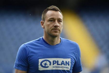 Chelsea's John Terry warms up before the match