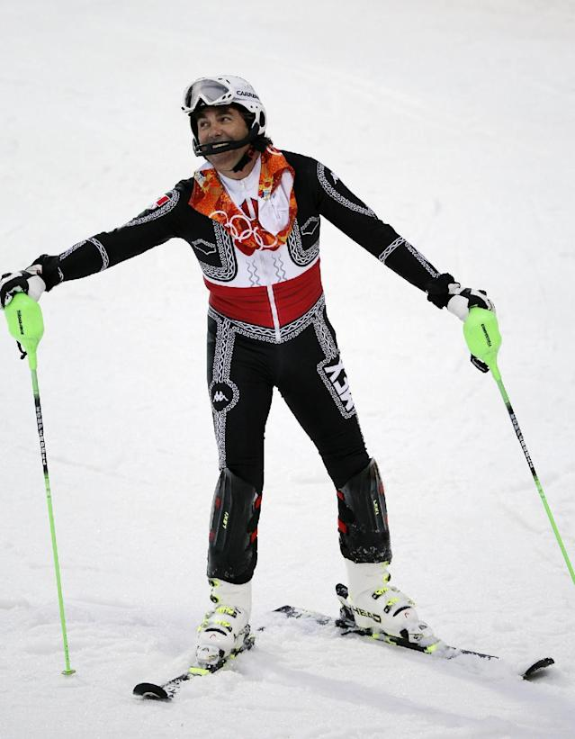 Mexico's Hubertus von Hohenlohe reacts after crashing during the first run of the men's slalom at the Sochi 2014 Winter Olympics, Saturday, Feb. 22, 2014, in Krasnaya Polyana, Russia. (AP Photo/Christophe Ena)