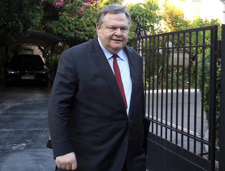 Socialist leader Evangelos Venizelos leaves the official residence of conservative Prime Minister Antonis Samaras in Athens on Monday, June 24, 2013. Members of Venizelos' PASOK party are expecded to be handed top posts in a cabinet reshuffle due to be finalized late Monday, in the wake of a political crisis triggered by Samaras' decision to shut down state broadcaster ERT. Samaras' year-old government narrowly avoided collapse after he ordered ERT's closure on June 11. Coalition member Democratic Left pulled out of the government last week, cutting its majority in parliament to just three seats. (AP Photo/Thanassis Stavrakis)