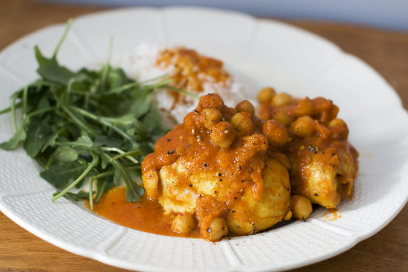 In this image taken on Jan. 21, 2013, speedy and light chicken curry is shown on a plate in Concord, N.H. (AP Photo/Matthew Mead)