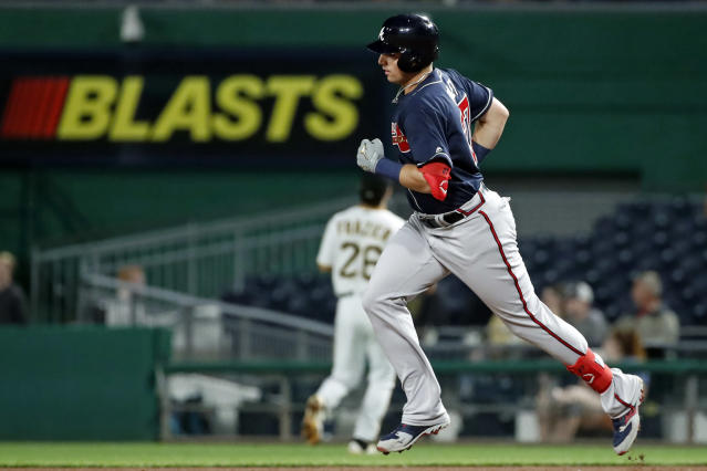 Atlanta Braves' Austin Riley, right, rounds first after hitting a three-run home run off Pittsburgh Pirates relief pitcher Kyle Crick during the seventh inning of a baseball game in Pittsburgh, Tuesday, June 4, 2019. (AP Photo/Gene J. Puskar)