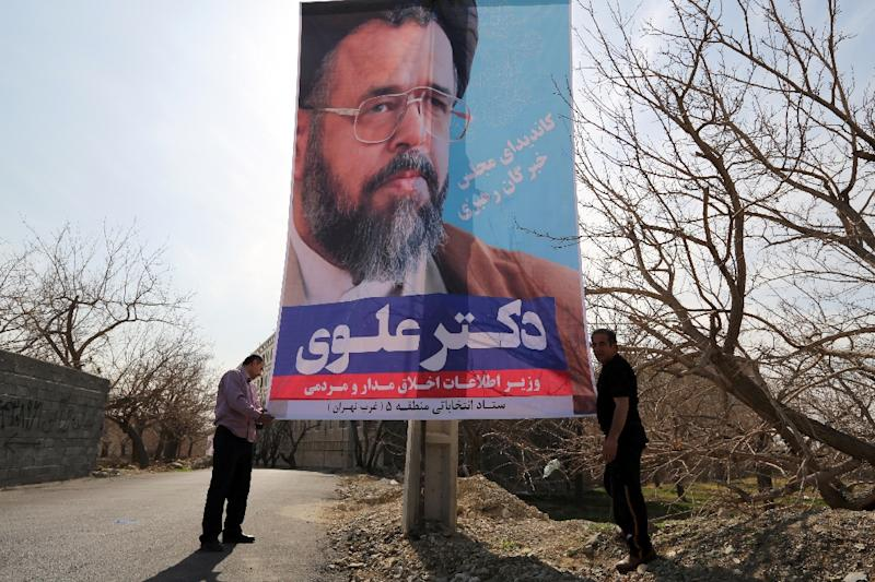 An election poster of Intelligence Minister Mahmoud Alavi on display in Tehran, on February 18, 2016 (AFP Photo/Atta Kenare)