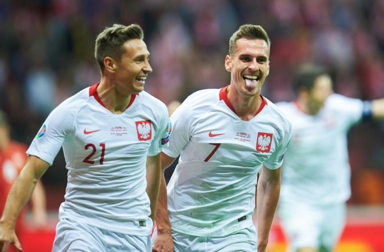 Chicago Fire player Przemyslaw Frankowski (L) made the crucial breakthrough for Poland
