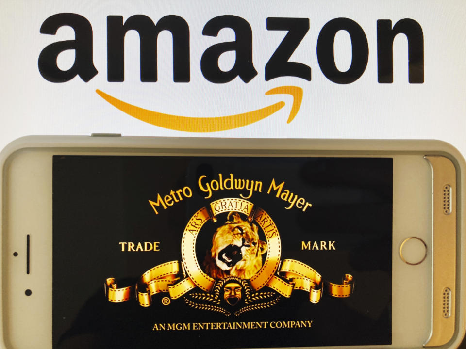 Photo by: STRF/STAR MAX/IPx 2021 5/26/21 Amazon buys MGM Studios for $8.45 Billion. STAR MAX Photo: Amazon and MGM logos photographed off multiple Apple devices.