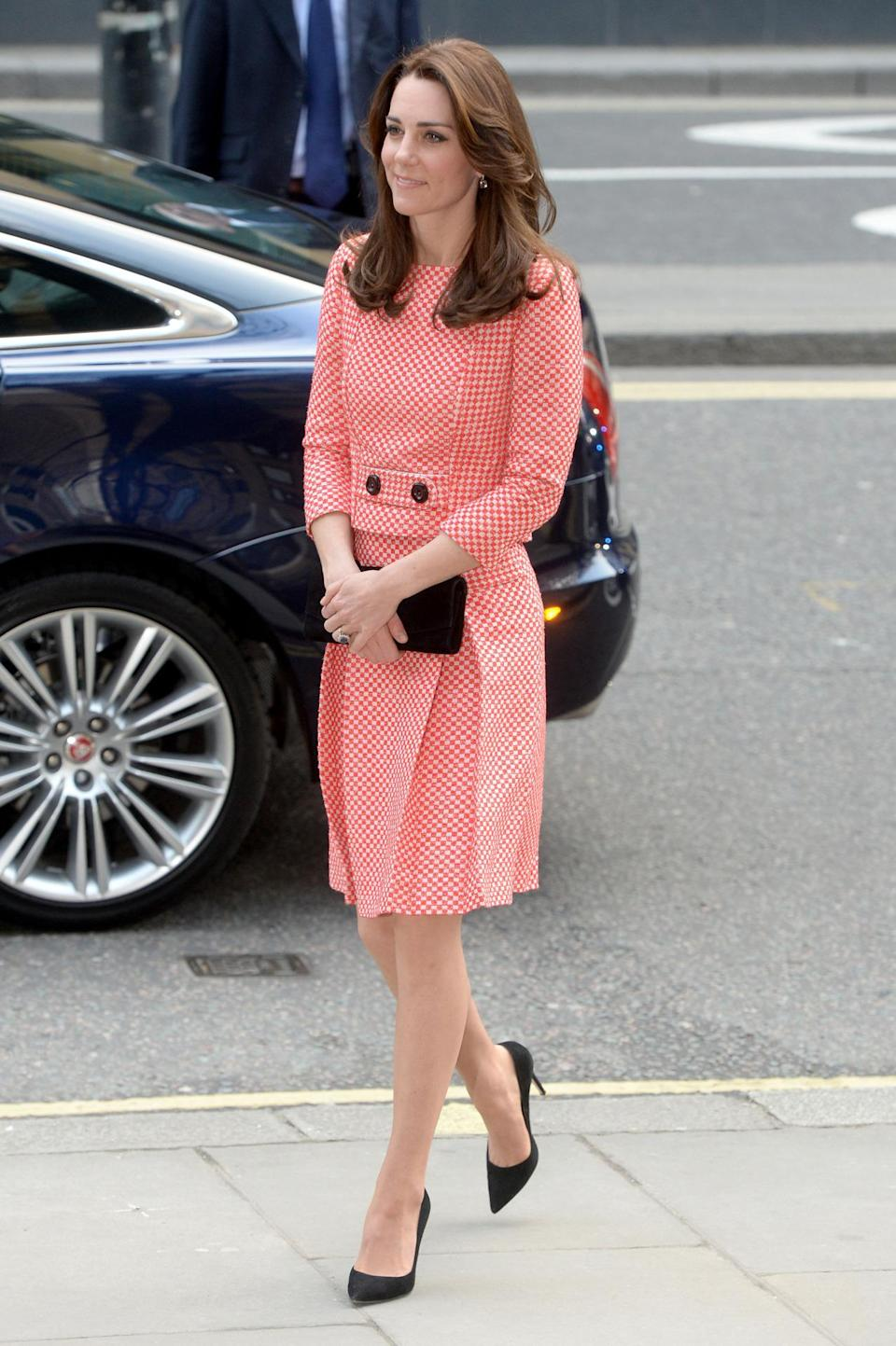 <p>While visiting a youth project in London, Kate donned a red-and-white gingham suit by Eponine London. She paired the outfit with black Gianvito Rossi pumps and a Stuart Weitzman bag. </p><p><i>[Photo: PA]</i></p>