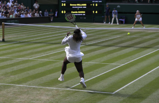 Serena Williams of the United States returns the ball to Italy's Camila Giorgi during their women's singles quarterfinals match at the Wimbledon Tennis Championships, in London, Tuesday July 10, 2018. (AP Photo/Kirsty Wigglesworth)