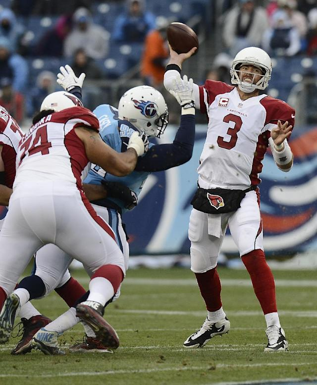 Arizona Cardinals quarterback Carson Palmer (3) passes as guard Paul Fanaika (74) blocks Tennessee Titans defensive tackle Jurrell Casey (99) in the first quarter of an NFL football game Sunday, Dec. 15, 2013, in Nashville, Tenn. (AP Photo/Mark Zaleski)