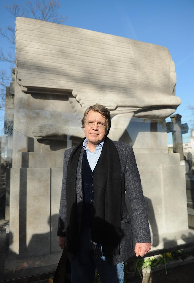 PARIS, FRANCE - NOVEMBER 30:  Journalist Merlin Holland, Oscar Wilde's only grandson, attends the unveiling of the newly renovated and protected tombstone of Oscar Wilde on the 111th anniversary Of the writer's death at Cimetierre du Pere Lachaise on November 30, 2011 in Paris, France. The tombstone has now been renovated and has a protective glass barrier erected in a joint effort by French and Irish government. Adoring fans and tourists have tradionally kissed the Jacob Epstein sculpted tombstone, with their lipstick and grease residue corroding the surface of the tomb over the years.  (Photo by Antoine Antoniol/Getty Images)