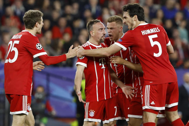 Bayern's Franck Ribery, center, celebrates with team mates after scoring his side's opening goal during the Champions League quarter final first leg soccer match between Sevilla FC and FC Bayern Munich at the Sanchez Pizjuan stadium in Seville, Spain, Tuesday, April 3, 2018. (AP Photo/Miguel Morenatti)