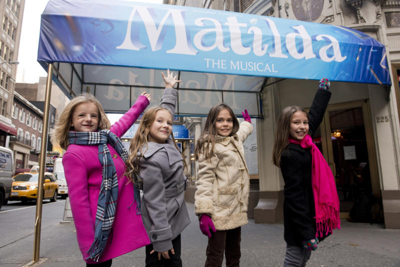 """FILE - This Nov. 15, 2012 file photo shows, from left, Milly Shapiro, Sophia Gennusa, Oona Laurence and Bailey Ryon posing for a portrait outside the Shubert Theatre in New York. The four young actresses share the title role in """"Matilda the Musical"""" on Broadway. (Photo by Charles Sykes/Invision/AP, file)"""