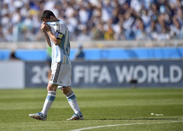 Argentina's Lionel Messi covers his face after missing a free kick during the group F World Cup soccer match between Argentina and Iran at the Mineirao Stadium in Belo Horizonte, Brazil, Saturday, June 21, 2014. (AP Photo/Martin Meissner)