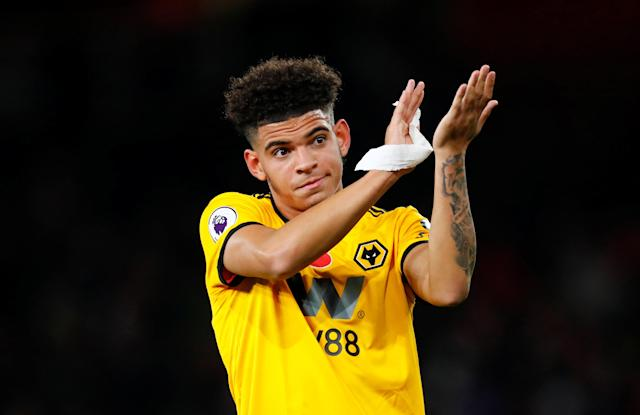 """Soccer Football - Premier League - Arsenal v Wolverhampton Wanderers - Emirates Stadium, London, Britain - November 11, 2018 Wolverhampton Wanderers' Morgan Gibbs-White applauds the fans after the match REUTERS/Eddie Keogh EDITORIAL USE ONLY. No use with unauthorized audio, video, data, fixture lists, club/league logos or """"live"""" services. Online in-match use limited to 75 images, no video emulation. No use in betting, games or single club/league/player publications. Please contact your account representative for further details."""