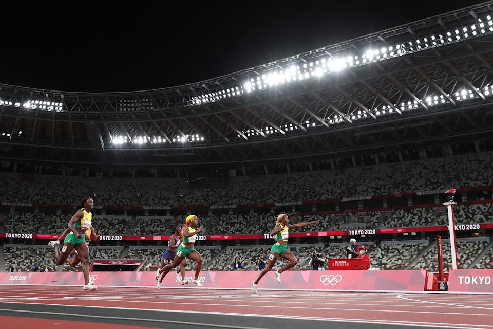 <p>TOKYO, JAPAN - JULY 31: Elaine Thompson-Herah of Team Jamaica celebrates before crossing the finish line to win the gold medal in the Women's 100m Final on day eight of the Tokyo 2020 Olympic Games at Olympic Stadium on July 31, 2021 in Tokyo, Japan. (Photo by Michael Steele/Getty Images)</p>