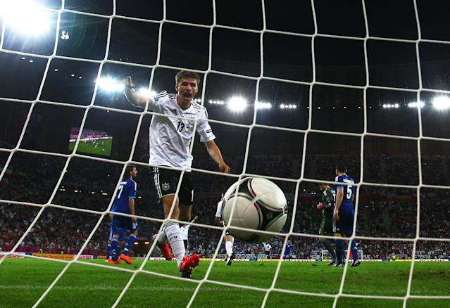 GDANSK, POLAND - JUNE 22: Philipp Lahm celebrates as Miroslav Klose of Germany (obscured) scores their third goal during the UEFA EURO 2012 quarter final match between Germany and Greece at The Municipal Stadium on June 22, 2012 in Gdansk, Poland. (Photo by Joern Pollex/Getty Images)