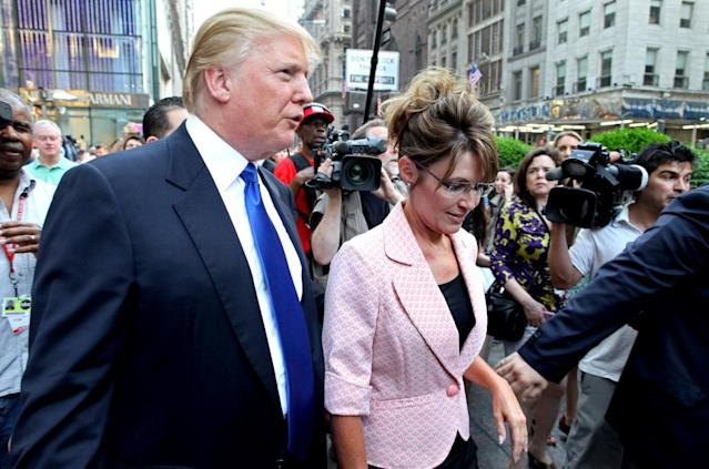 <p>Former Alaska Gov. Sarah Palin walks with Trump in New York City on May 31, 2011. <i>(Photo: Craig Ruttle/AP)</i> </p>