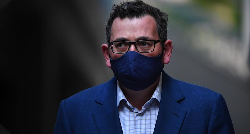 Dan Andrews has faced criticism from the federal government over what they believe is a stringent exit from lockdown. Source: AAP