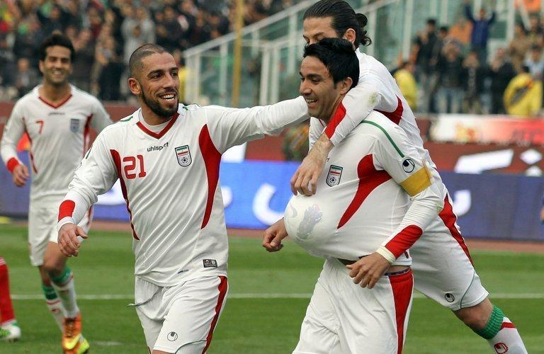 Javad Nekounam (right) celebrates after scoring for Iran against Lebanon in Tehran on February 6, 2013