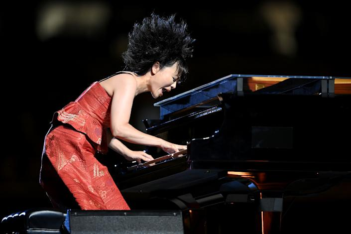 <p>TOKYO, JAPAN - JULY 23: A Japanese jazz composer Hiromi Uehara plays the piano during the Opening Ceremony of the Tokyo 2020 Olympic Games at Olympic Stadium on July 23, 2021 in Tokyo, Japan. (Photo by Matthias Hangst/Getty Images)</p>