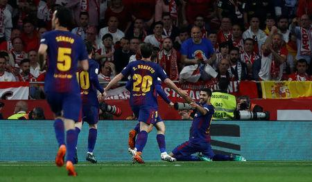 Soccer Football - Spanish King's Cup Final - FC Barcelona v Sevilla - Wanda Metropolitano, Madrid, Spain - April 21, 2018 Barcelona's Luis Suarez celebrates scoring their third goal with team mates REUTERS/Juan Medina