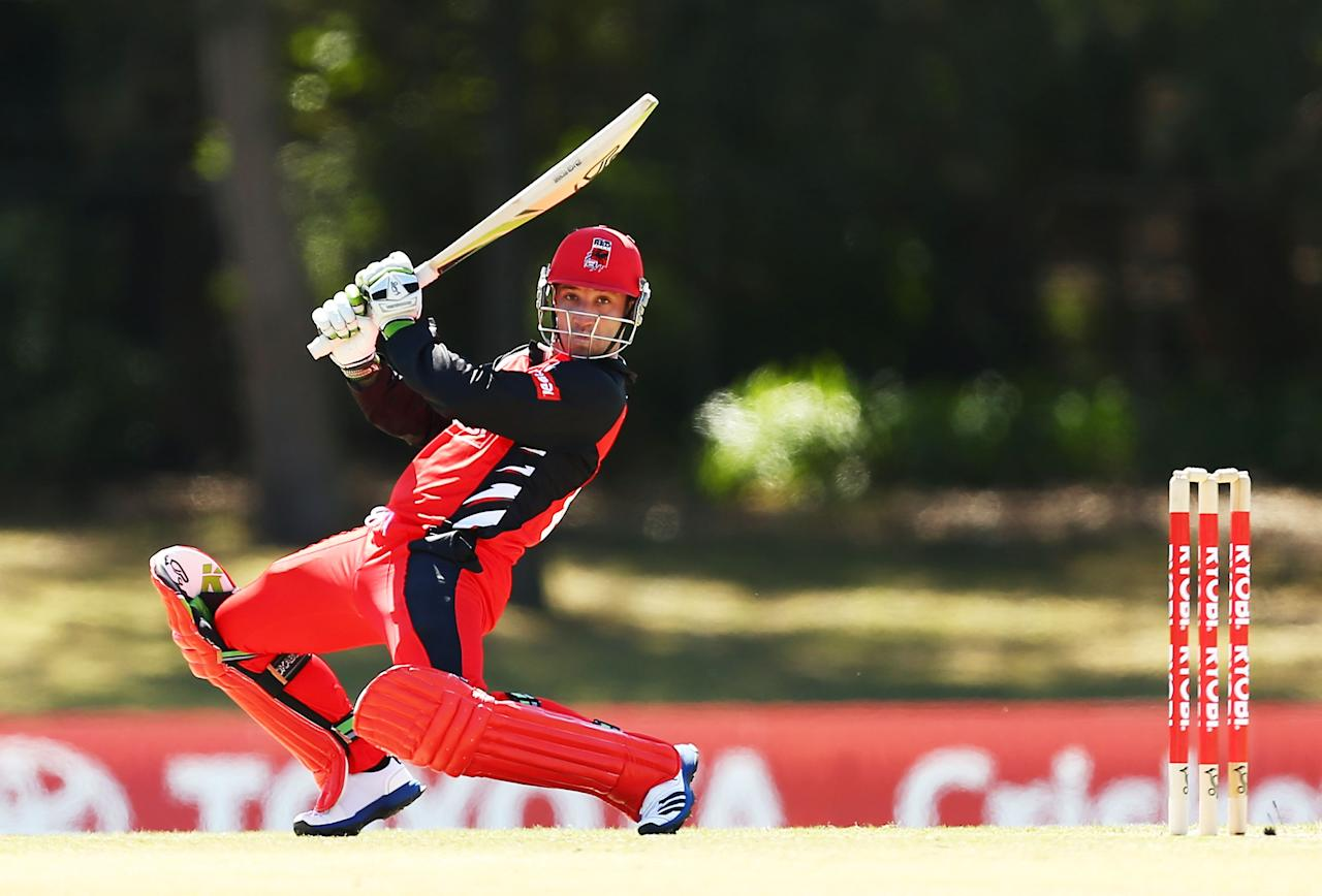 SYDNEY, AUSTRALIA - OCTOBER 04:  Phillip Hughes of the Redbacks plays a cut shot during the Ryobi Cup match between the South Australia Redbacks and the Victoria Bushrangers at Bankstown Oval on October 4, 2013 in Sydney, Australia.  (Photo by Matt King/Getty Images)