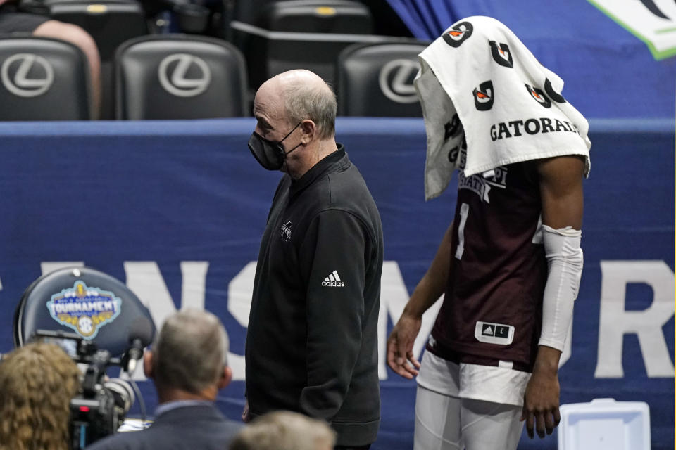 Mississippi State head coach Ben Howland and Iverson Molinar (1) leave the court after a loss to Alabama in an NCAA college basketball game in the Southeastern Conference Tournament Friday, March 12, 2021, in Nashville, Tenn. (AP Photo/Mark Humphrey)