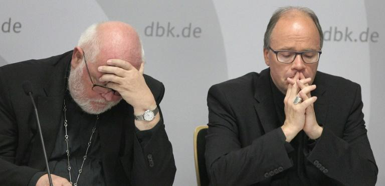 Cardinal Reinhard Marx (L) said he was ashamed over the decades of abuse carried out by Catholic Church officials in Germany