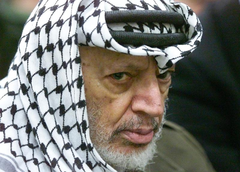FILE - In this May 31, 2002 file photo photo Palestinian leader Yasser Arafat pauses during the weekly Muslim Friday prayers in his headquarters in the West Bank city of Ramallah. Yasser Arafat's body may be exhumed to allow for more testing of the causes of his death, the Palestinian president said Wednesday, July 4, 2012, after a Swiss lab said it found elevated levels of a radioactive isotope in belongings the Palestinian leader is said to have used in his final days. (AP Photo/Lefteris Pitarakis, File)