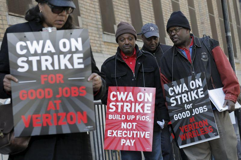 Members of the CWA picket in front of Verizon Communications Inc. corporate offices during a strike in New York