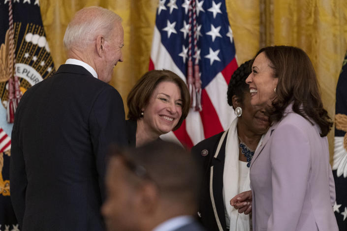 President Joe Biden, Sen. Amy Klobuchar, D-Minn., center, and Vice President Kamala Harris, right, share a laugh after the president signed H.R. 1652, the VOCA Fix to Sustain the Crime Victims Fund Act of 2021, in the East Room of the White House in Washington, Thursday, July 22, 2021. (AP Photo/Andrew Harnik)