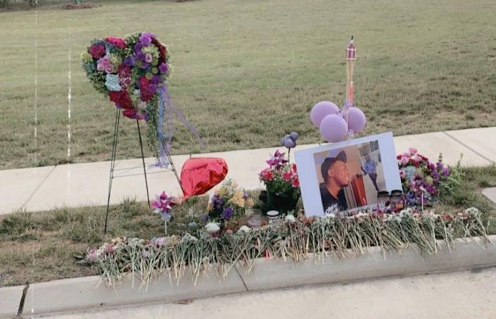 Family and friends created a memorial for Damion Robinson on Bles Park Drive in Ashburn at the site of the crash where Robinson died. (Courtesy of Selena Drincic)