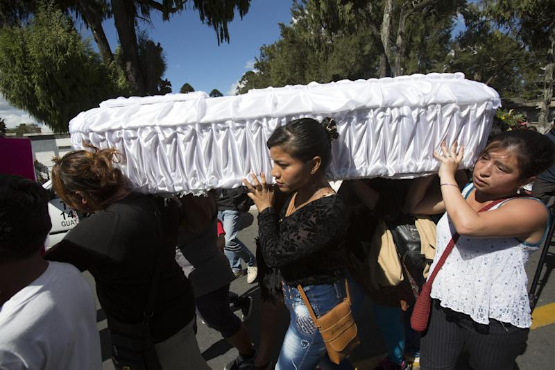 Women carry the coffin containing the remains of 17-year-old Siona Hernandez Garcia, a girl who died in a fire at the Virgin of the Assumption Safe Home, at the Guatemala City's cemetery, Friday, March 10, 2017. Families began burying some of the 36 girls killed in a fire at an overcrowded government-run youth shelter in Guatemala as authorities worked to determine exactly what happened. (AP Photo/Moises Castillo)