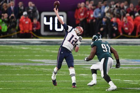 Feb 4, 2018; Minneapolis, MN, USA; New England Patriots quarterback Tom Brady (12) attempts to throw a touchdown during the final seconds of the fourth quarter as Philadelphia Eagles defensive tackle Fletcher Cox (91) defends in Super Bowl LII at U.S. Bank Stadium. Mandatory Credit: John David Mercer-USA TODAY Sports