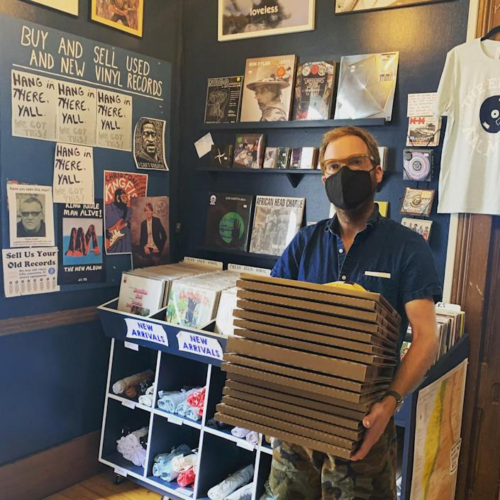 David Swider carries boxed up records ready to be picked up by the U.S. Postal Service at his store The End of All Music in Oxford, Miss. (Courtesy David Swider)