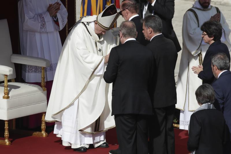 Pope Francis meets Jose Mauricio Moreira, of Salvador, center right, whose healing from glaucoma was considered a miracle that led to the canonization of Dulce Lopes Pontes, in St. Peter's Square at the Vatican, Sunday, Oct. 13, 2019. Francis presided over Mass on Sunday in a packed St. Peter's Square to declare Cardinal John Henry Newman and four women saints. (AP Photo/Alessandra Tarantino)