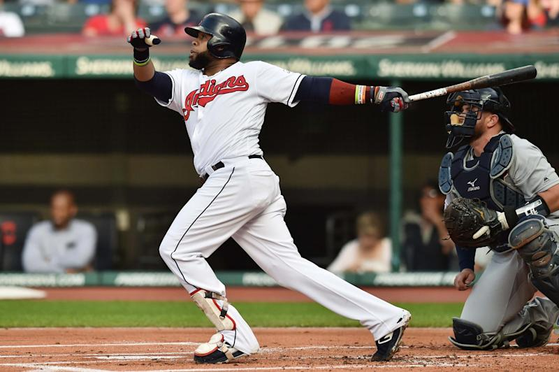 Cleveland Indians first baseman Carlos Santana (41) hits a home run during the first inning against the Detroit Tigers at Progressive Field on June 21, 2019 in Cleveland, Ohio.