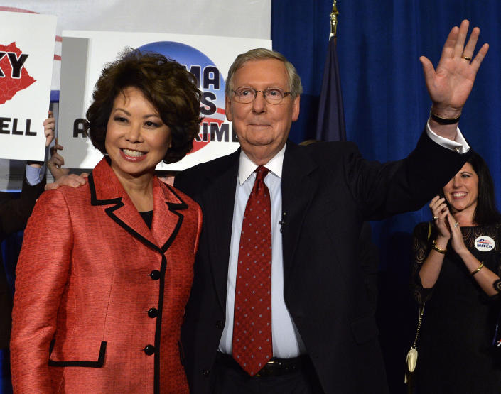 Kentucky Sen. Mitch McConnell and his wife, Elaine Chao, wave to his supporters after his victory in the Republican primary on May 20. (Timothy D. Easley/AP)