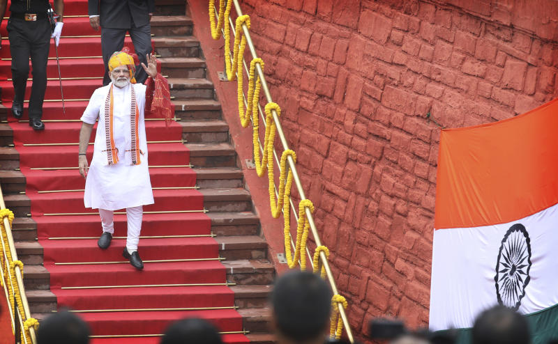 Indian Prime Minister Narendra Modi waves as he leaves after addressing the nation on the country's Independence Day from the ramparts of the historical Red Fort in New Delhi, India, Thursday, Aug. 15, 2019. Modi said that stripping the disputed Kashmir region of its statehood and special constitutional provisions has helped unify the country. Modi gave the annual Independence Day address from the historic Red Fort in New Delhi as an unprecedented security lockdown kept people in Indian-administered Kashmir indoors for an eleventh day. (AP Photo/Manish Swarup)