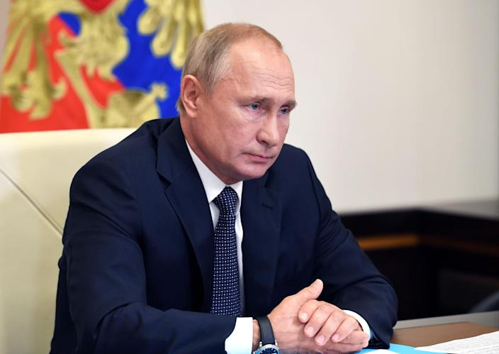 Russian President Vladimir Putin chairs a teleconference call at the Novo-Ogaryovo state residence outside Moscow on Tuesday. (Alexey Nikolsky/Sputnik/AFP via Getty Images)