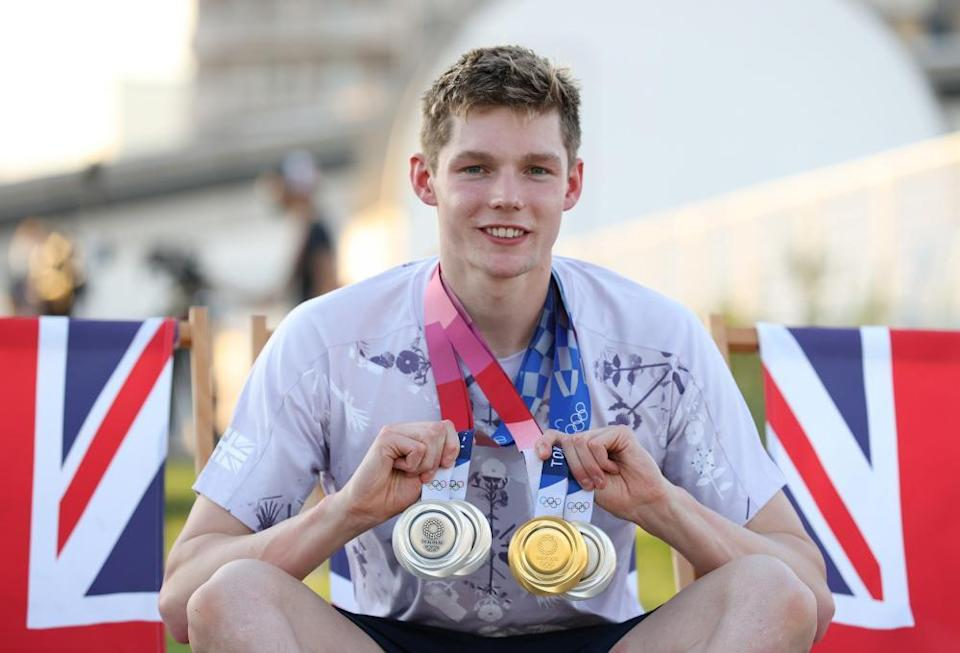Duncan Scott with his haul of one gold and three silver medals from Tokyo.