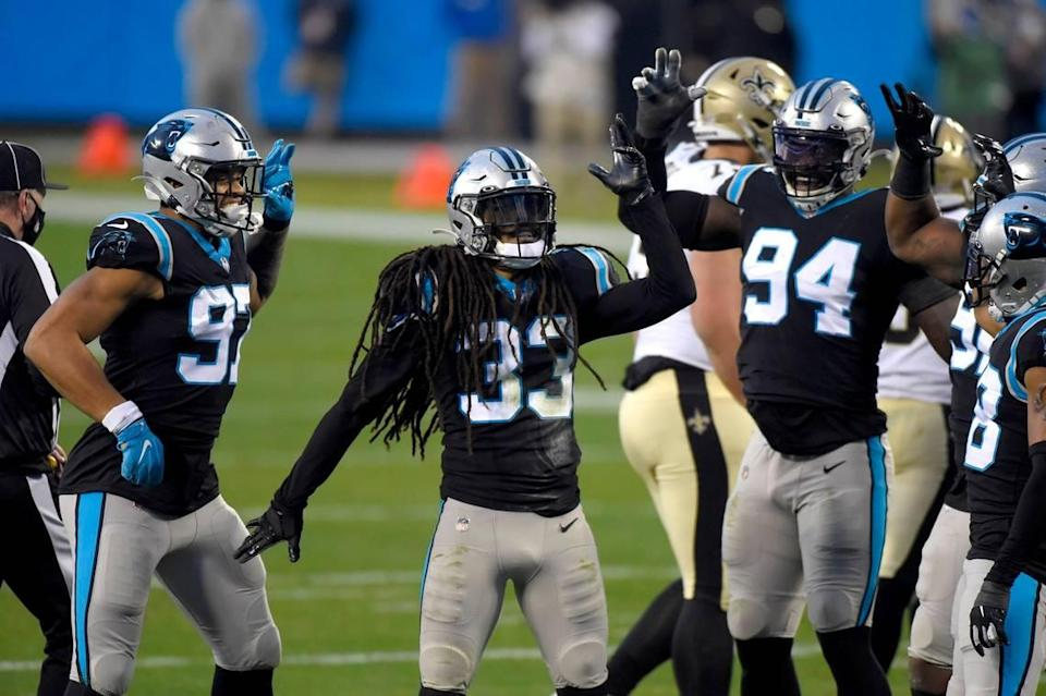 Carolina Panthers safety Tre Boston, center, celebrates his sack of New Orleans Saints quarterback Drew Brees during first half action at Bank of America Stadium on Sunday, January 3, 2021.