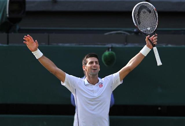 Serbia's Novak Djokovic celebrates winning his men's singles final match against Switzerland's Roger Federer on day thirteen of the 2014 Wimbledon Championships at The All England Tennis Club in Wimbledon, southwest London, on July 6, 2014 (AFP Photo/Glyn Kirk)